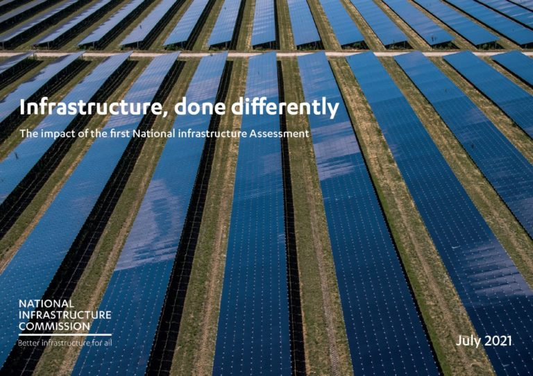 The front cover shows a large solar power plant