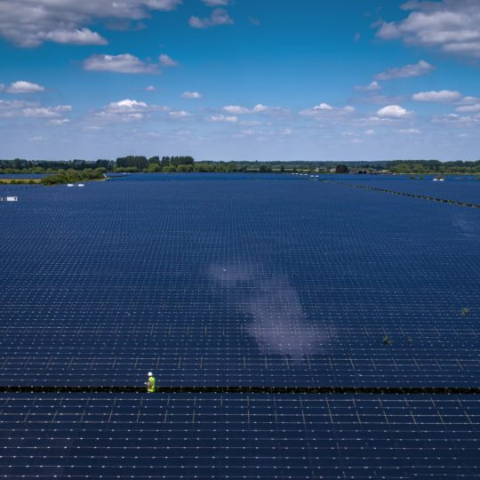Man among huge solar power plant