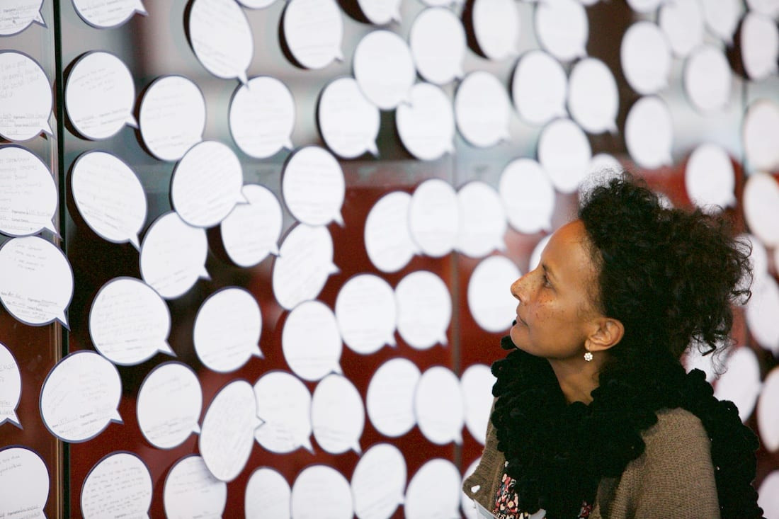 Woman looking at speech bubbles