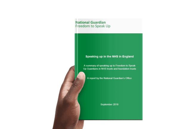 Hand holding an NGO report