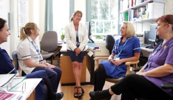 Guardian talking to a group of nurses